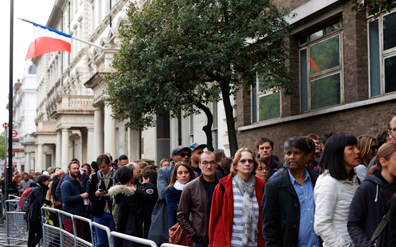 French nationals in long queues outside the Lycee Francais Charles de Gaulle in London - Credit: AFP