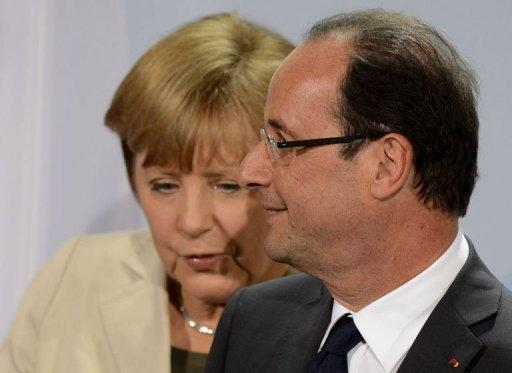 German Chancellor Angela Merkel and new French president Francois Hollande attend a press conference at the German Chancellery in Berlin. Merkel and Hollande Tuesday stressed a shared desire to keep Greece in the eurozone, with the new French president adding that all options must be kept open in confronting the crisis