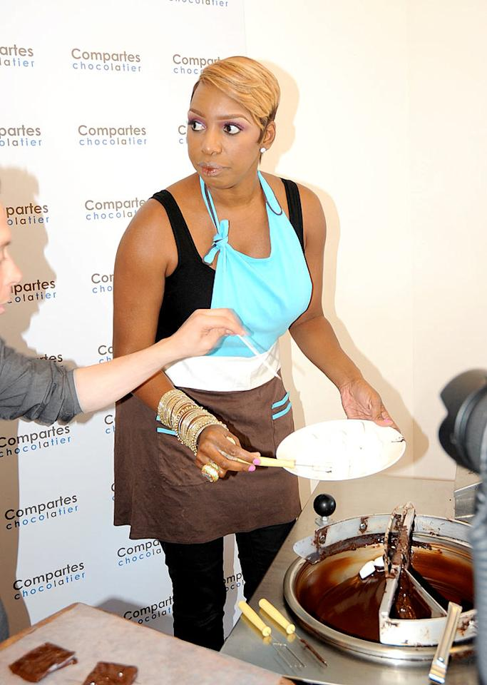 """Wanting to show off her sweeter side, NeNe agreed to dish out chocolate -- and gossip! -- for a couple hours at Comparte's Chocolatier. Green/<a href=""""http://www.x17online.com"""" target=""""new"""">X17 Online</a> - June 28, 2010"""