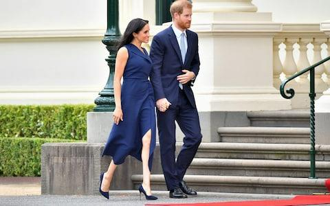 The Duke and Duchess of Sussex leave the crowds to attend a reception hosted by the governor of Victoria - Credit: Samir Hussein/WireImage
