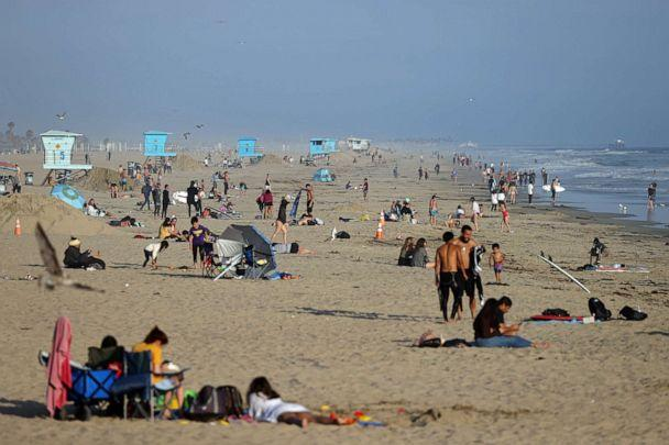 PHOTO: People gather at the beach on April 30, 2020 in Huntington Beach, Calif. (Michael Heiman/Getty Images)