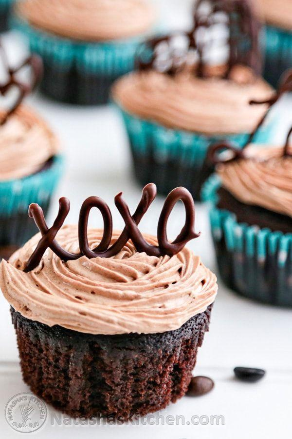 """<p>Use melted chocolate to write out sweet nothings to your Valentine.</p><p><a href=""""http://natashaskitchen.com/2013/01/23/moist-chocolate-cupcakes-with-prague-frosting/"""" rel=""""nofollow noopener"""" target=""""_blank"""" data-ylk=""""slk:Get the recipe from Natasha's Kitchen »"""" class=""""link rapid-noclick-resp""""><em>Get the recipe from Natasha's Kitchen »</em></a></p>"""