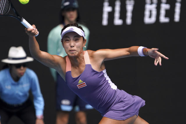 China's Wang Qiang makes a forehand return to Serena Williams of the U.S. in their third round match at the Australian Open tennis championship in Melbourne, Australia, Friday, Jan. 24, 2020. (AP Photo/Lee Jin-man)