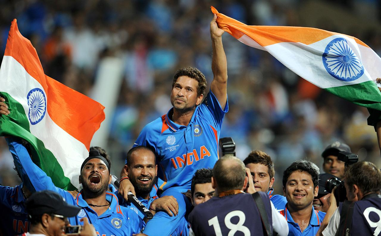 (FILES) In this photograph taken  on April 2, 2011, Indian batsman Sachin Tendulkar is carried on his teammates' shoulders after India defeated Sri Lanka in the ICC Cricket World Cup 2011 final played at The Wankhede Stadium in Mumbai.  India's record-breaking batsman Sachin Tendulkar on December 23, 2012 announced his retirement from one-day cricket, the Board of Control for Cricket in India (BCCI) said.  AFP PHOTO/William WEST/FILES        (Photo credit should read WILLIAM WEST/AFP/Getty Images)