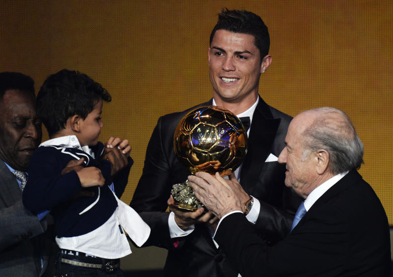 Cristiano Ronaldo of Portugal, center, is awarded the prize for the FIFA Men's soccer player of the year 2013 by FIFA President Sepp Blatter, right, at the FIFA Ballon d'Or 2013 gala at the Kongresshaus in Zurich, Switzerland, Monday, Jan. 13, 2014. (AP Photo, Keystone/Steffen Schmidt)