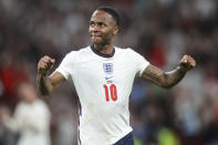 England's Raheem Sterling celebrates his side's 2-1 win at the end of the Euro 2020 soccer championship semifinal match between England and Denmark at Wembley stadium in London, Wednesday, July 7, 2021. (AP Photo/Carl Recine, Pool)
