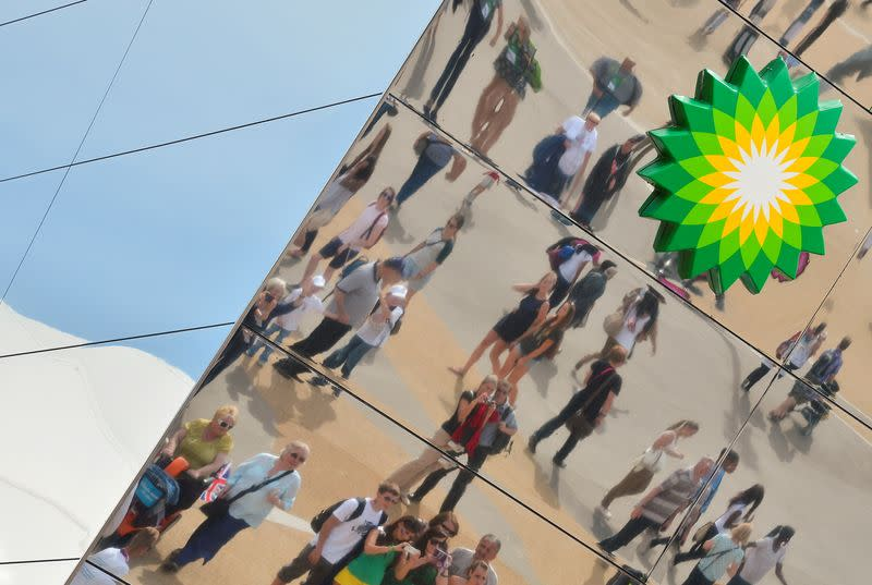 FILE PHOTO: Spectators are seen reflected in a British Petroleum sponsors building in Olympic Park at the London 2012 Paralympic Games