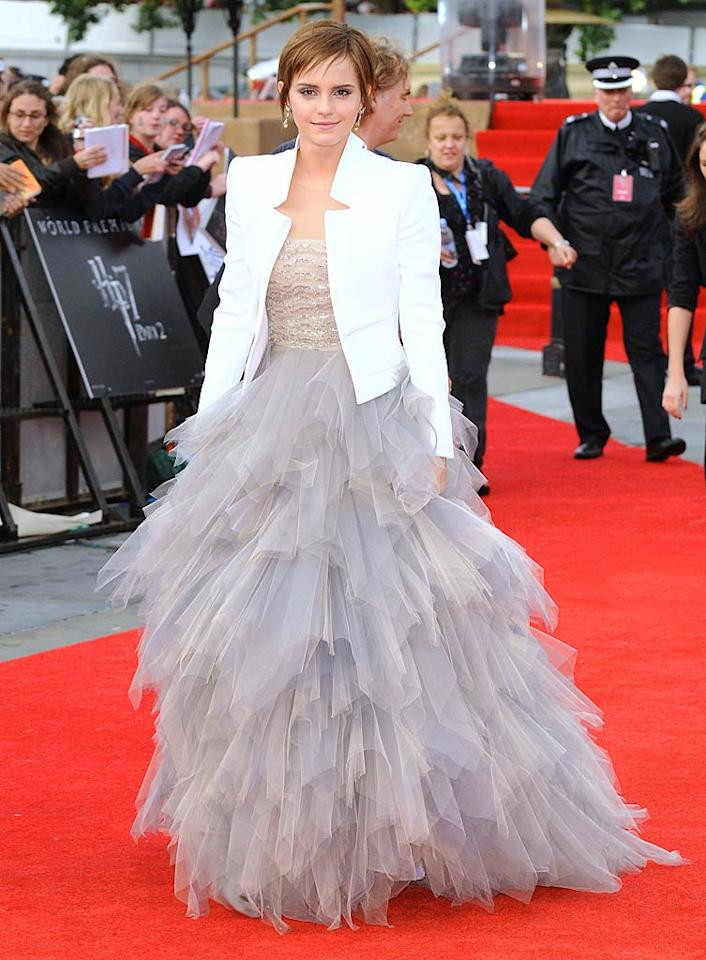 """Across the pond, Emma Watson made her grand entrance at the London premiere of """"Harry Potter and the Deathly Hallows - Part 2"""" in a voluminous Oscar de la Renta ballgown featuring a beaded bodice and tulle skirt. The 21-year-old actress topped off her fairytale-like frock with a crisp white Antonio Berardi crepe jacket. Simply smashing! James Whatling/<a href=""""http://www.splashnewsonline.com"""" target=""""new"""">Splash News</a> - July 7, 2011"""
