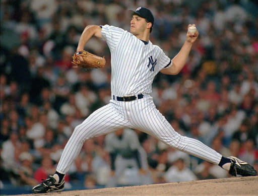 FILE - In this Oct. 4, 1995, file photo, New York Yankees pitcher Andy Pettitte throws against the Seattle Mariners in the first inning of Game two of the American League division playoff series at Yankee Stadium in New York. Pettitte was selected in the 22nd round of the Baseball Draft. (AP Photo/John Dunn, File)