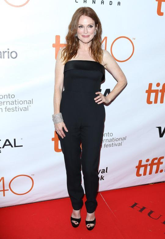 "<p>The beauty of a jumpsuit is that it can be dressed both up and down. Julianne Moore played her Hugo Boss piece perfectly at the ""Freeheld"" premiere, accessorizing the black number with a diamond cuff and diamond earrings.</p>"