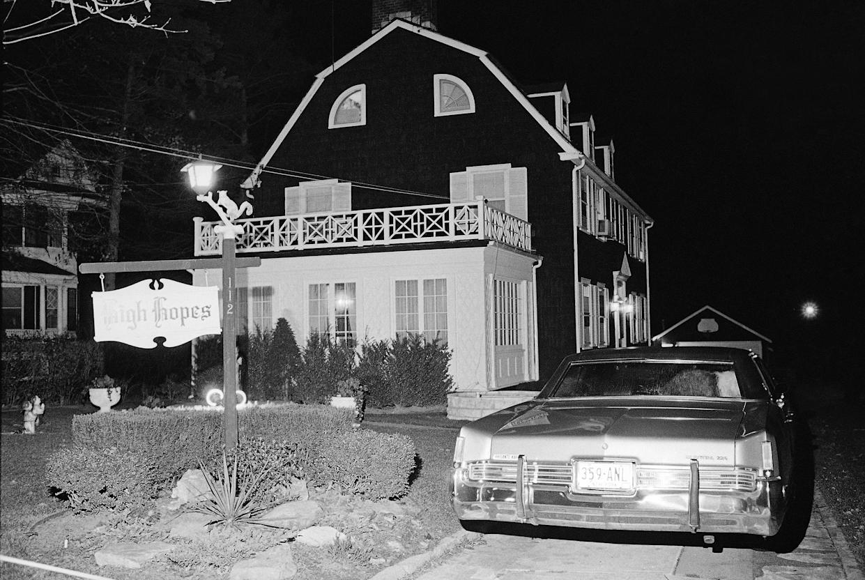 In this Nov. 14, 1974 file photo, police and members of the Suffolk County Coroner's Office investigate the murder of six people found shot in Amityville, N.Y. (Photo: AP Photo/Richard Drew)