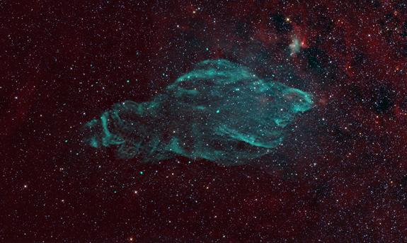 The W50 supernova remnant, shown in radio (green) against the infrared background of stars and dust (red), is being nicknamed the Manatee Nebula.