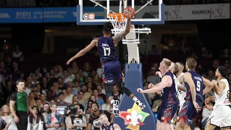 Eric Griffin gets above the rim during Adelaide's win over Melbourne United in the NBL