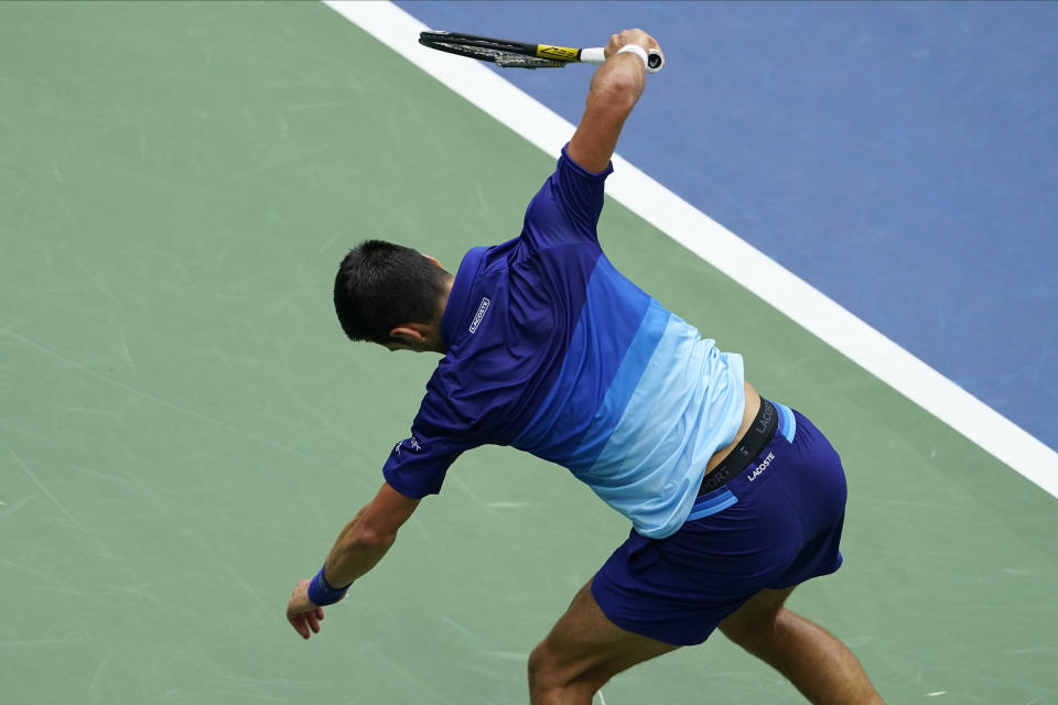 Novak Djokovic, of Serbia, smashes his racket after losing a point to Daniil Medvedev, of Russia, during the men's singles final of the US Open tennis championships, Sunday, Sept. 12, 2021, in New York. (AP Photo/Seth Wenig)