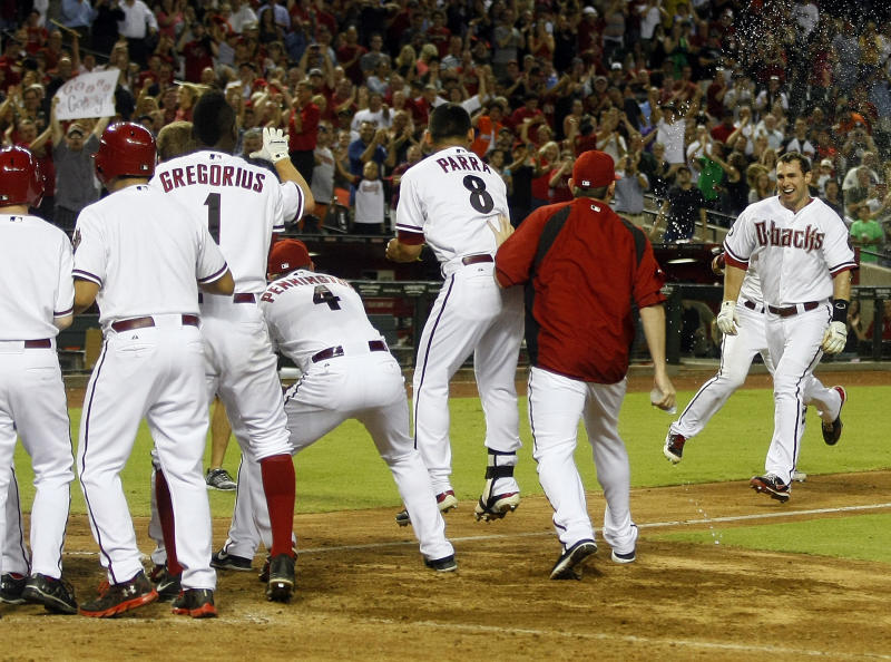 Arizona Diamondbacks first baseman Paul Goldschmidt (44), right, runs home after hitting a walk off homerun against the Baltimore Orioles during a baseball game on Tuesday, Aug. 13, 2013, in Phoenix. (AP Photo/Rick Scuteri)