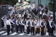 People against the Tokyo 2020 Olympics set to open in July, march to protest around Tokyo's National Stadium during an anti-Olympics demonstration Sunday, May 9, 2021. (AP Photo/Eugene Hoshiko)