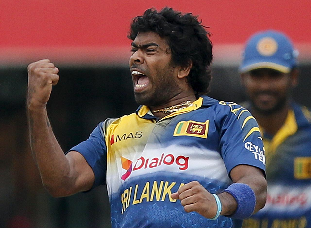 Sri Lanka's Lasith Malinga celebrates after taking the wicket of Pakistan's Ahmed Shehzad (not pictured) during their third One Day International cricket match in Colombo July 19, 2015. REUTERS/Dinuka Liyanawatte