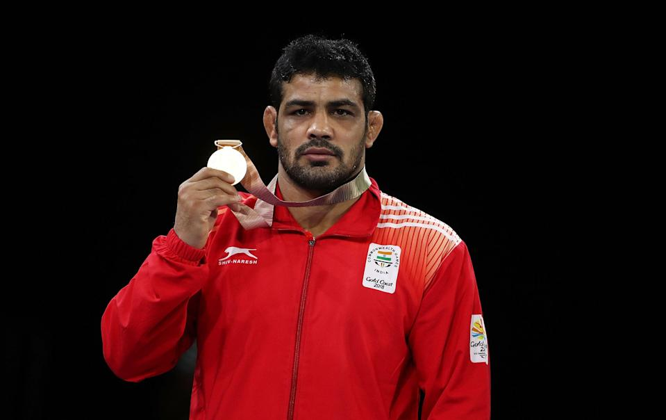 India's gold medalist Sushil Kumar poses during the medal ceremony for the Men's Freestyle 74 kg during the Wrestling on day eight of the Gold Coast 2018 Commonwealth Games at Carrara Sports and Leisure Centre (Getty Images)