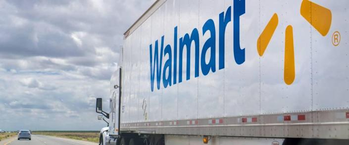 Walmart truck driving on the interstate on a cloudy day