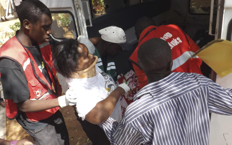 A woman injured in a grenade attack at the Utawala Inter-denominational church is helped into ambulance in Garissa, northern Kenya, Sunday, Nov. 4, 2012. The Kenya Red Cross says at least 10 people were wounded in the grenade attack. (AP Photo/Daud Yusuf)