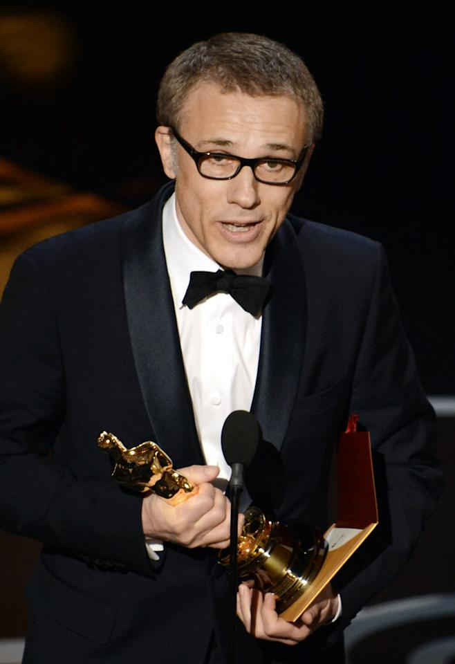 """HOLLYWOOD, CA - FEBRUARY 24:  Actor Christoph Waltz accepts the Best Supporting Actor award for """"Django Unchained"""" onstage during the Oscars held at the Dolby Theatre on February 24, 2013 in Hollywood, California.  (Photo by Kevin Winter/Getty Images)"""