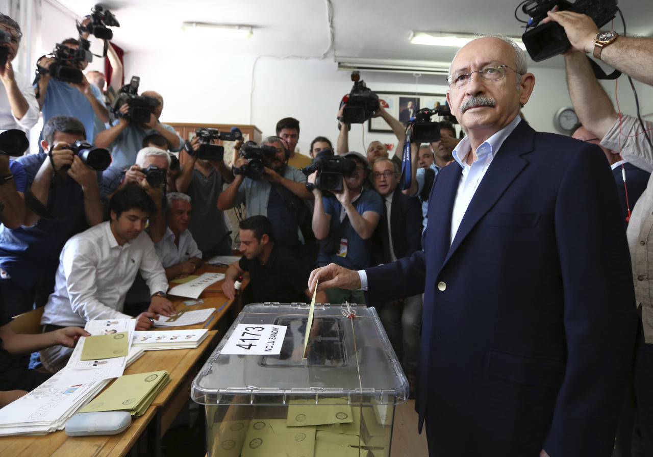 Kemal Kilicdaroglu, main opposition Republican People's Party leader, casts his ballot at a primary school in Ankara, Turkey, Sunday, June 24, 2018. Polls opened Sunday for Turkey's high-stakes presidential and parliamentary elections, which could consolidate President Recep Tayyip Erdogan's hold on power or curtail his vast political ambition. (AP Photo/Ali Unal)