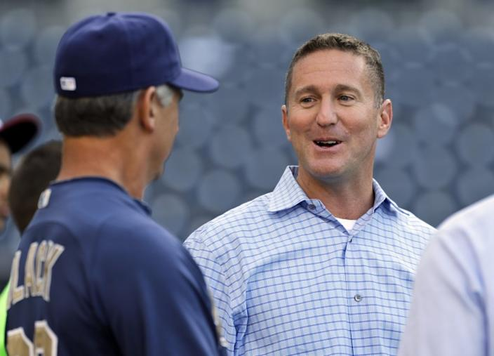 San Diego Padres general manager Josh Byrnes talks with manager Buddy Black before a baseball game against the Los Angeles Dodgers in San Diego, Wednesday, April 10, 2013. (AP Photo/Lenny Ignelzi)