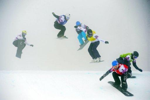 The Ladies' Snowboard Cross finals race near the Russian Black Sea resort of Sochi on February 17, 2013. Italian Michela Moioli won the race. Tajikistan may be the poorest of the five former Soviet Republics but that does not stop it from dreaming big on the sporting front