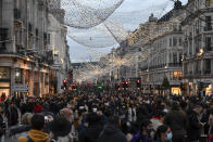 FILE - In this Saturday, Dec. 12, 2020 file photo crowds of shoppers walk under the Christmas lights in Regent Street, in London. Health Secretary Matt Hancock says infections are starting to rise in some areas after falling during a four-week national lockdown in England that ended Dec. 2. (AP Photo/Alberto Pezzali, File)