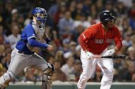 Boston Red Sox's Rafael Devers, right, runs on his RBI-single in front of Toronto Blue Jays' Danny Jansen during the eighth inning of a baseball game in Boston, Friday, June 21, 2019. (AP Photo/Michael Dwyer)