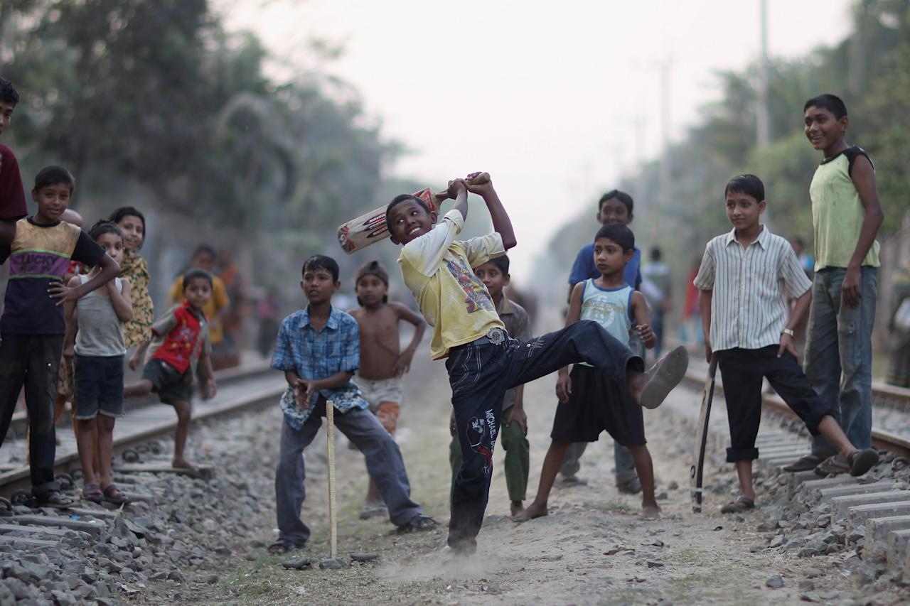 CHITTAGONG, BANGLADESH - MARCH 10:  Children play cricket on the railway tracks on March 10, 2011 in Chittagong, Bangladesh.  (Photo by Tom Shaw/Getty Images)