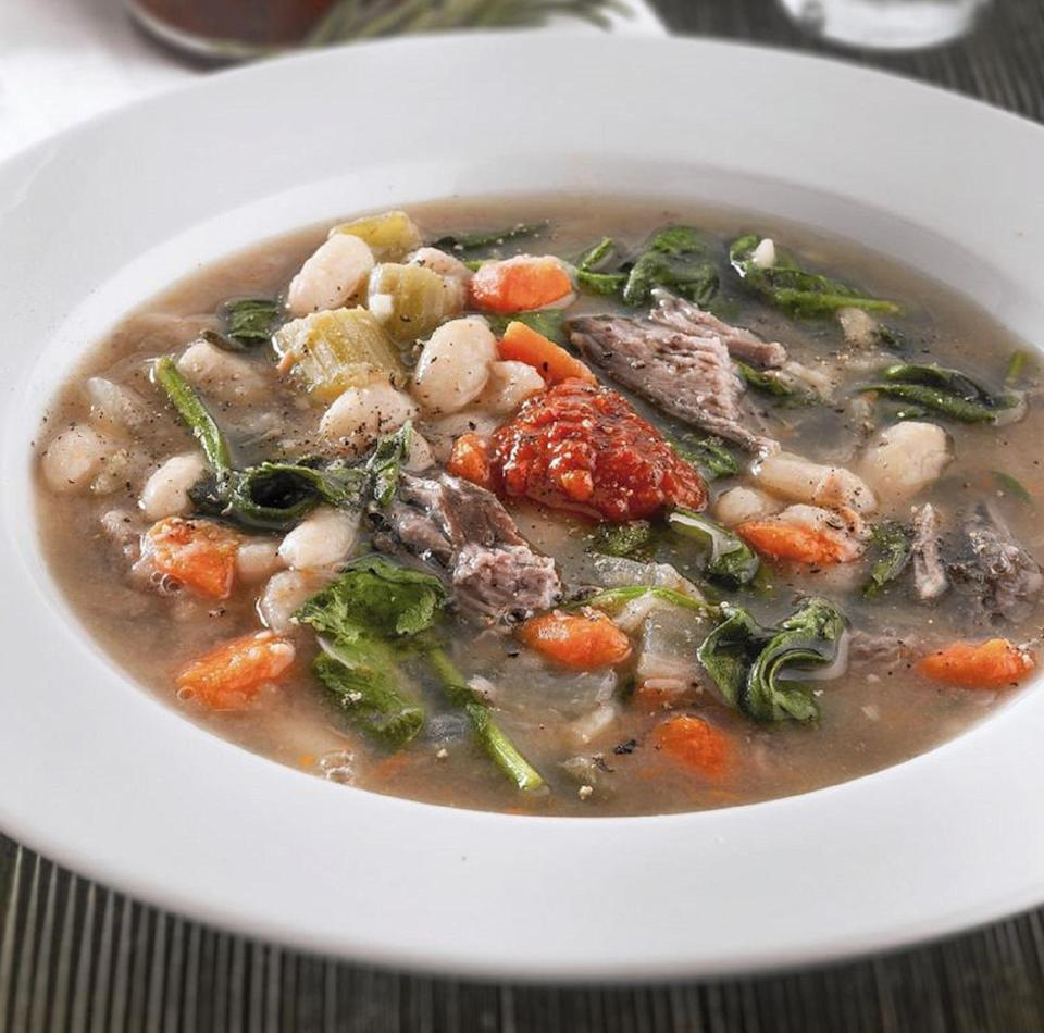 """<p>This stew will have your house smelling incredible. Make this lamb stew in the morning and allow the meat and other ingredients to slowly simmer throughout the day. By the time you're ready for dinner, you'll have a yummy stew you can eat after a <a href=""""https://www.thedailymeal.com/recipes-weeknight-dinners-simple?referrer=yahoo&category=beauty_food&include_utm=1&utm_medium=referral&utm_source=yahoo&utm_campaign=feed"""" rel=""""nofollow noopener"""" target=""""_blank"""" data-ylk=""""slk:busy day"""" class=""""link rapid-noclick-resp"""">busy day</a>.</p> <p><a href=""""https://www.thedailymeal.com/recipes/hearty-lamb-stew-recipe?referrer=yahoo&category=beauty_food&include_utm=1&utm_medium=referral&utm_source=yahoo&utm_campaign=feed"""" rel=""""nofollow noopener"""" target=""""_blank"""" data-ylk=""""slk:For the Hearty Lamb Stew recipe, click here."""" class=""""link rapid-noclick-resp"""">For the Hearty Lamb Stew recipe, click here.</a></p>"""