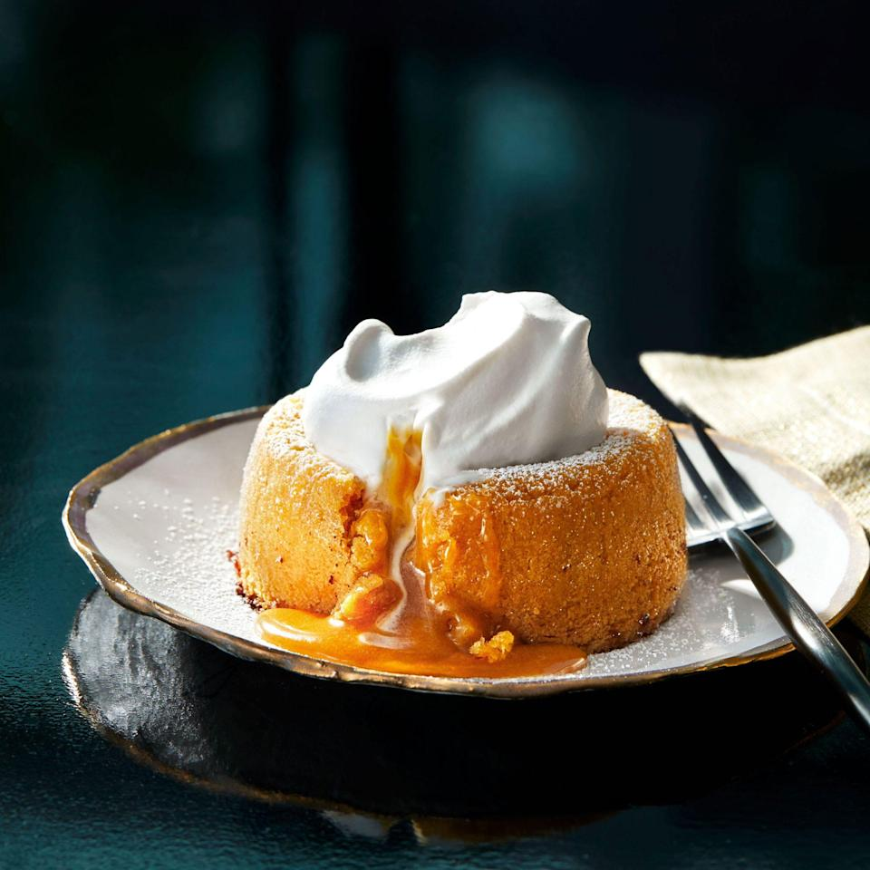 """<p><strong>Recipe: <a href=""""https://www.southernliving.com/recipes/butterscotch-bourbon-lava-cake"""" rel=""""nofollow noopener"""" target=""""_blank"""" data-ylk=""""slk:Butterscotch-Bourbon Lava Cakes"""" class=""""link rapid-noclick-resp"""">Butterscotch-Bourbon Lava Cakes</a></strong></p> <p>Butterscotch balances out the bourbon in this lava cake batter for the perfect finishing touch.</p>"""