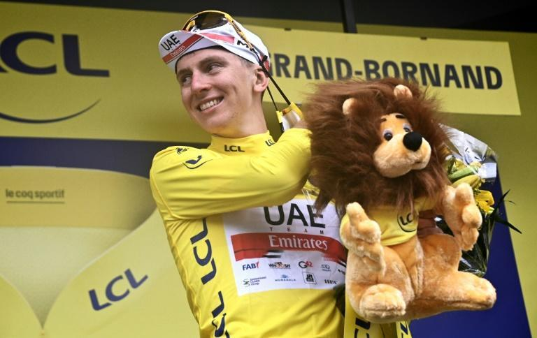 Tadej Pogacar pulls on the yellow jersey after laying down the law