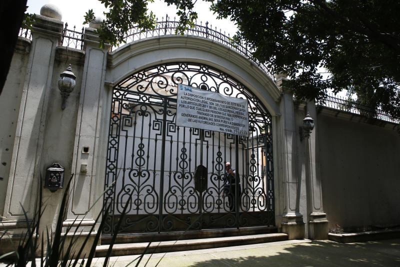 The entrance gate to the mansion of Chinese-Mexican businessman Zhenli Ye Gon during a media tour in Mexico City, Tuesday, July 30, 2019. The federal government said Monday it will hold an Aug. 11 auction for the Mexico City mansion worth $5 million (95 million Mexican pesos) that previously belonged to the suspected drug trafficker. (AP Photo/Ginnette Riquelme)