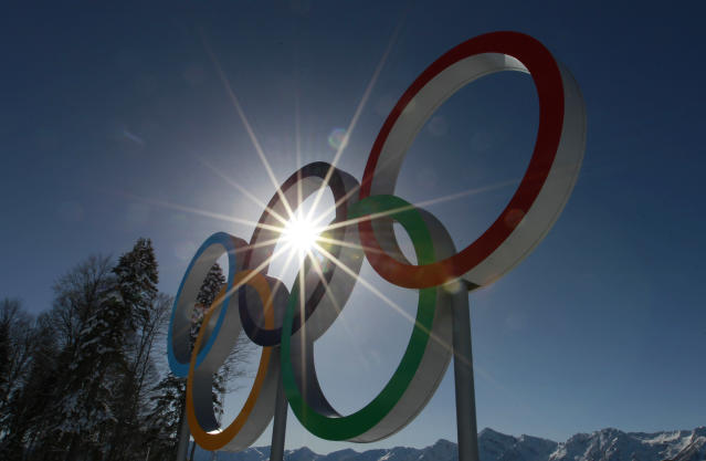 The sun shines through the Olympic rings at the Cross Country stadium at the 2014 Winter Olympics, Tuesday, Feb. 4, 2014, in Krasnaya Polyana, Russia. (AP Photo/Gregorio Borgia)
