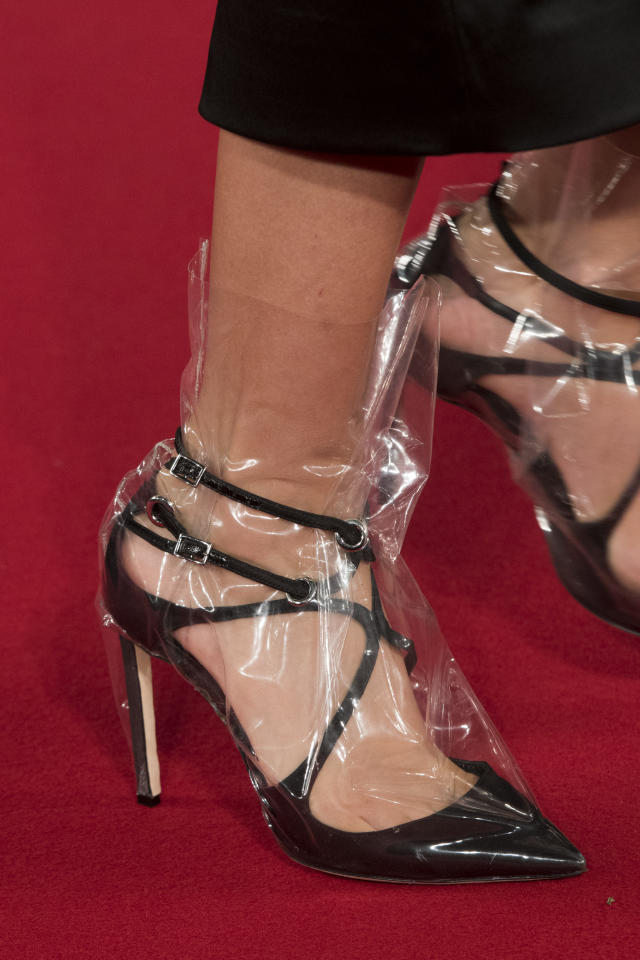<p><i>Black pumps wrapped in clear plastic from the SS18 Off-White collection. (Photo: ImaxTree) </i></p>