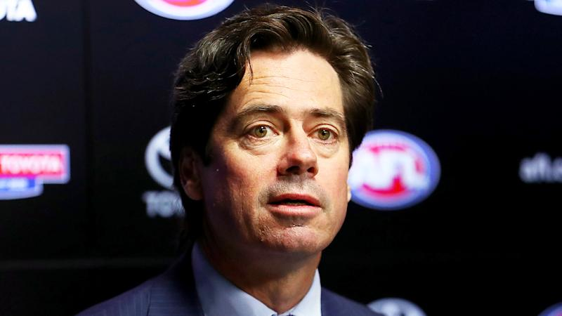 AFL CEO Gillon McLachlan, pictured during a press conference, says the league is ready to play games without fans in attendance.