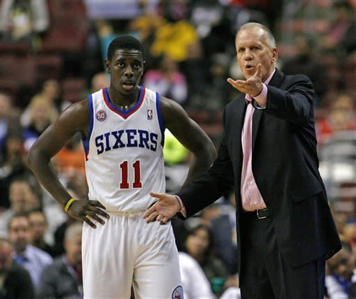 Philadelphia 76ers coach Doug Collins talks to Jrue Holiday (11) during a tine out against the Detroit Pistons in the first half of an NBA basketball game Wednesday Nov. 14, 2012 in Philadelphia. (AP Photo/ H. Rumph Jr)