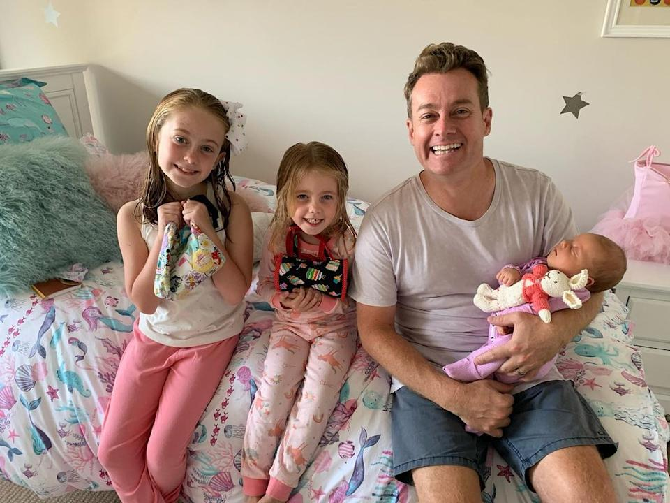 Grant Denyer and his three daughters