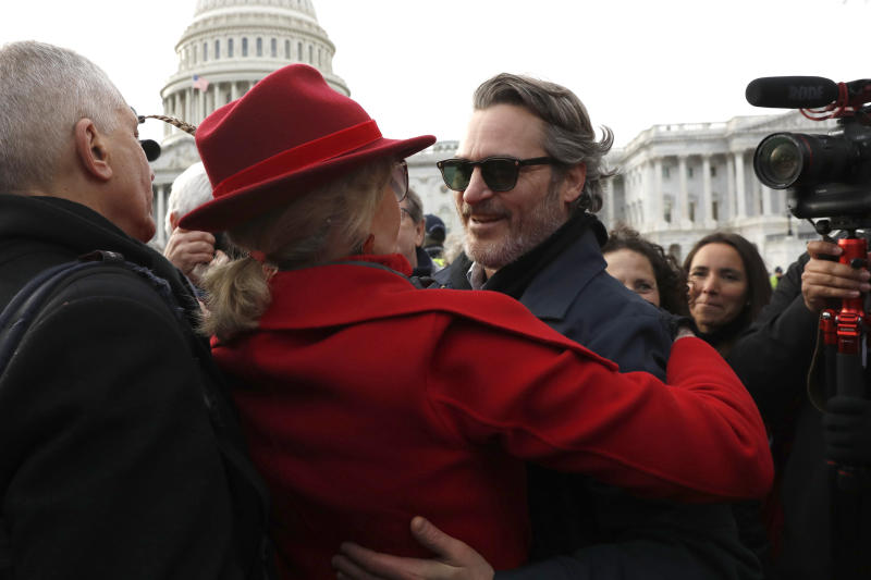 Actress and activist Jane Fonda hugs actor Joaquin Phoenix outside the U.S. Capitol during a protest on climate change Friday, Jan. 10, 2020, on Capitol Hill in Washington. (AP Photo/ Jacquelyn Martin)