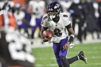 Baltimore Ravens quarterback Lamar Jackson (8) rushes for a 17-yard touchdown during the first half of an NFL football game against the Cleveland Browns, Monday, Dec. 14, 2020, in Cleveland. (AP Photo/David Richard)