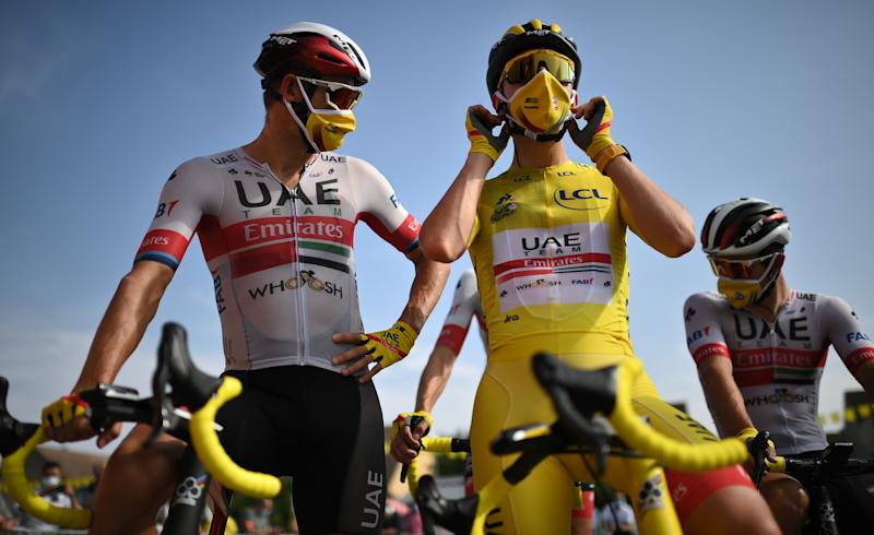 Team UAE Emirates rider Slovenias Tadej Pogacar wearing the overall leaders yellow jersey and his teammates wait prior to the 21st and last stage of the 107th edition of the Tour de France cycling race 122 km between ManteslaJolie and Champs Elysees Paris on September 20 2020 Photo by Marco BERTORELLO POOL AFP Photo by MARCO BERTORELLOPOOLAFP via Getty Images