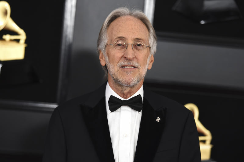 """FILE - This Feb. 10, 2019 file photo shows then President and CEO of The Recording Academy Neil Portnow at the 61st annual Grammy Awards in Los Angeles. Portnow says a rape allegation against him aired in a complaint against the Recording Academy by his successor is """"false and outrageous."""" Portnow released a statement saying the academy during his tenure had conducted a thorough and independent investigation and he was """"completely exonerated."""" (Photo by Jordan Strauss/Invision/AP, File)"""