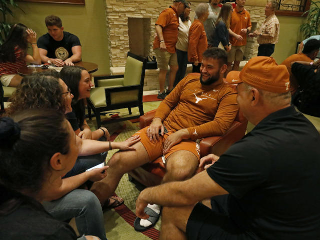 Texas Longhorns' Samuel Cosmi talks with family members Friday Sept. 6, 2019 at the team hotel in Austin, Tx. ( Photo by Edward A. Ornelas )