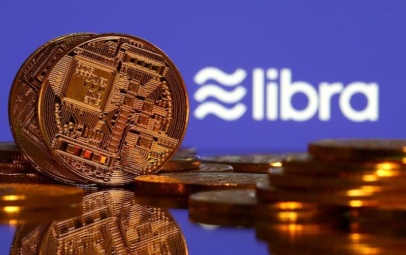 The virtual currency representations are displayed in front of the Libra logo in this illustration, image, June 21, 2019. REUTERS / Dado Ruvic / Illustration