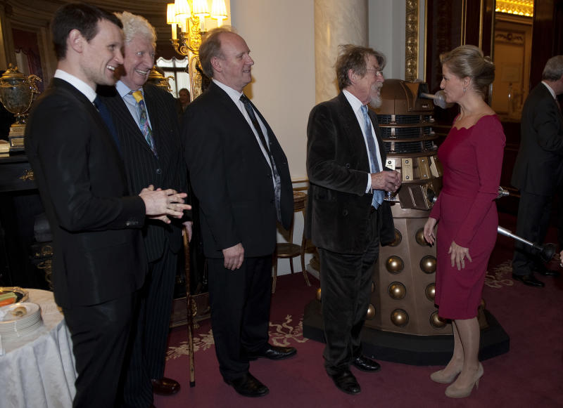 LONDON, ENGLAND - NOVEMBER 18: Sophie, Countess of Wessex (R) meets past and present Doctor Who actors (L-R) Matt Smith, Tom Baker, Peter Davison and John Hurt during a reception to mark the 50th anniversary of the hit TV series at Buckingham Palace as british actor Peter Davison, the fifth incarnation of the Doctor role looks on, onNovember 18, 2013 in London, England. Sophie, Countess of Wessex hosted a reception to mark the 50th anniversary of the TV series in which there have been 11 Doctors to date. It now holds the Guinness World Record for the longest running science fiction series in the world. (Photo by Eddie Mulholland - WPA Pool/Getty Images)
