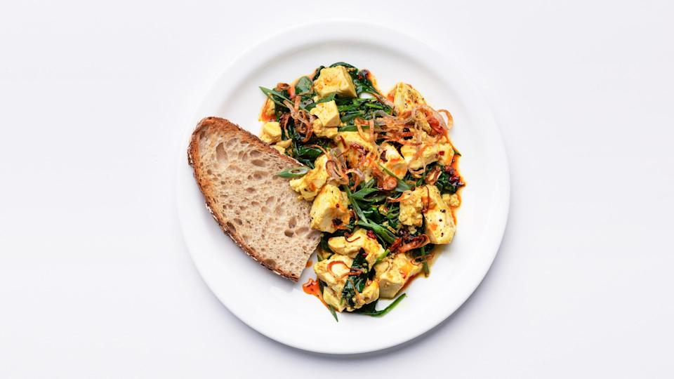 """Spicy, creamy silken tofu with all of the crunchy toppings your heart desires. <a href=""""https://www.bonappetit.com/recipe/ginger-scallion-tofu-scramble-with-spinach-and-chili-oil?mbid=synd_yahoo_rss"""" rel=""""nofollow noopener"""" target=""""_blank"""" data-ylk=""""slk:See recipe."""" class=""""link rapid-noclick-resp"""">See recipe.</a>"""