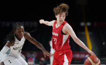 Japan's Saki Hayashi (27), right, steals the ball from Nigeria's Promise Amukamara (10), left, during women's basketball preliminary round game at the 2020 Summer Olympics, Monday, Aug. 2, 2021, in Saitama, Japan. (AP Photo/Charlie Neibergall)