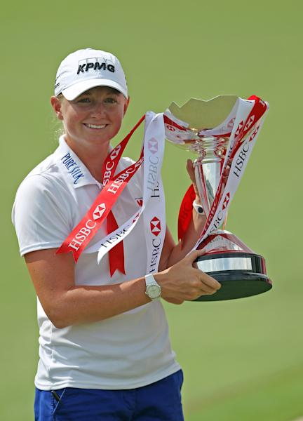 Stacy Lewis of the United States poes with the challenge trophy after winning the HSBC Women's Champions golf tournament on Sunday, March 3, 2013 in Singapore. (AP Photo/Wong Maye-E)